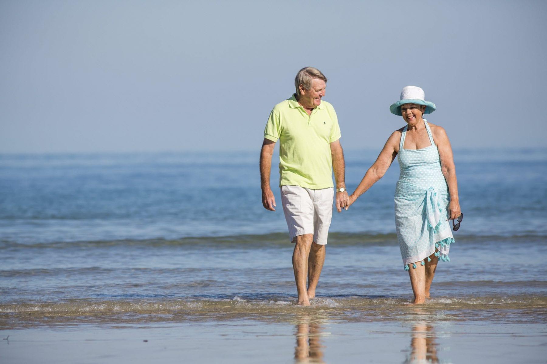 two older people walking on fleurieu
