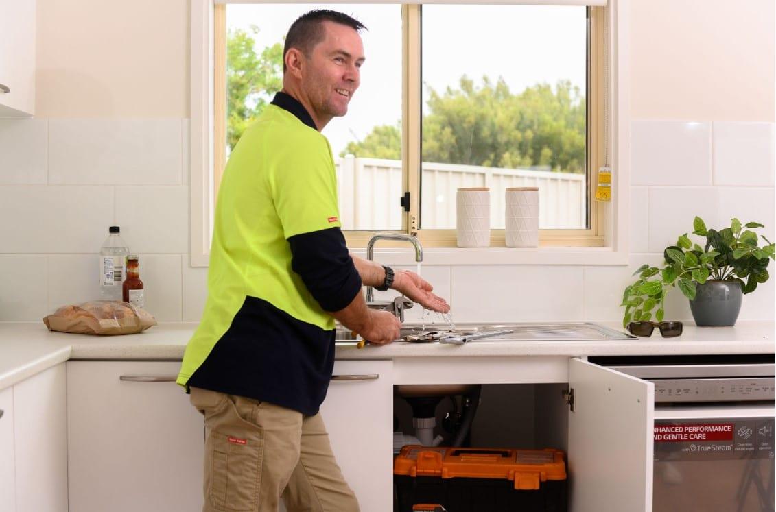 maintenance man at sink