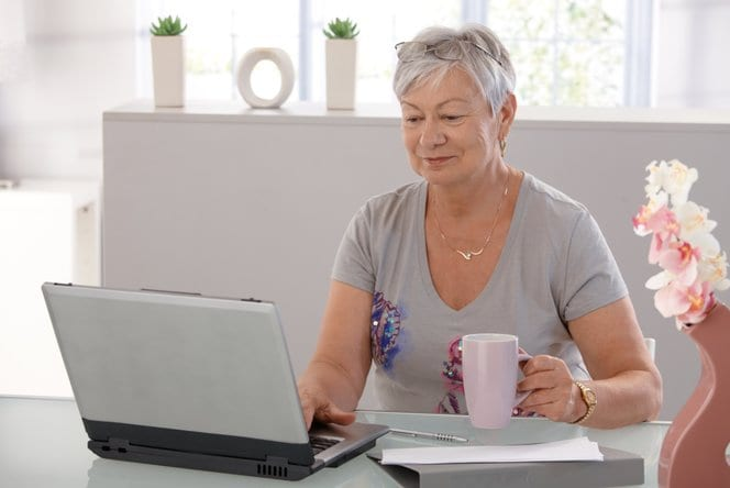 Old woman staying connected during coronavirus pandemic