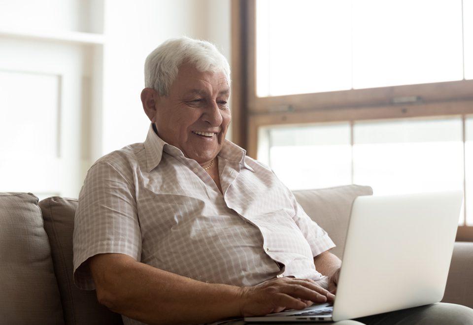 Older man playing online games