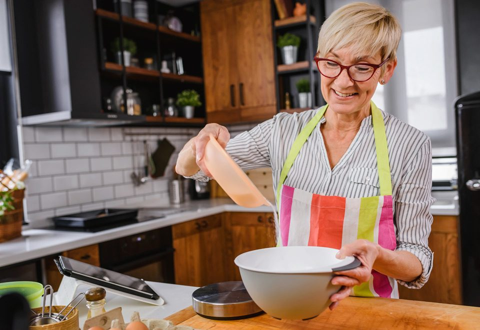 older woman cooking in the kitchen