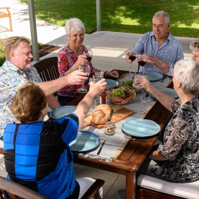 Group of retirees dining outside