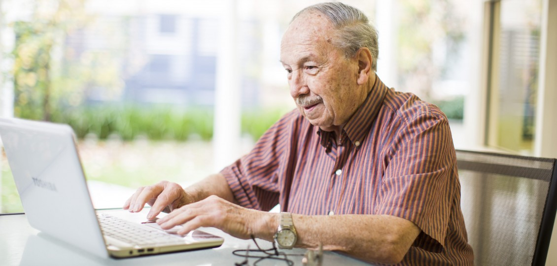 man using computer at vita residential care home