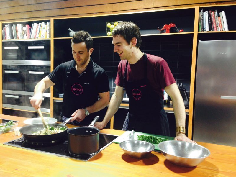 two men cooking