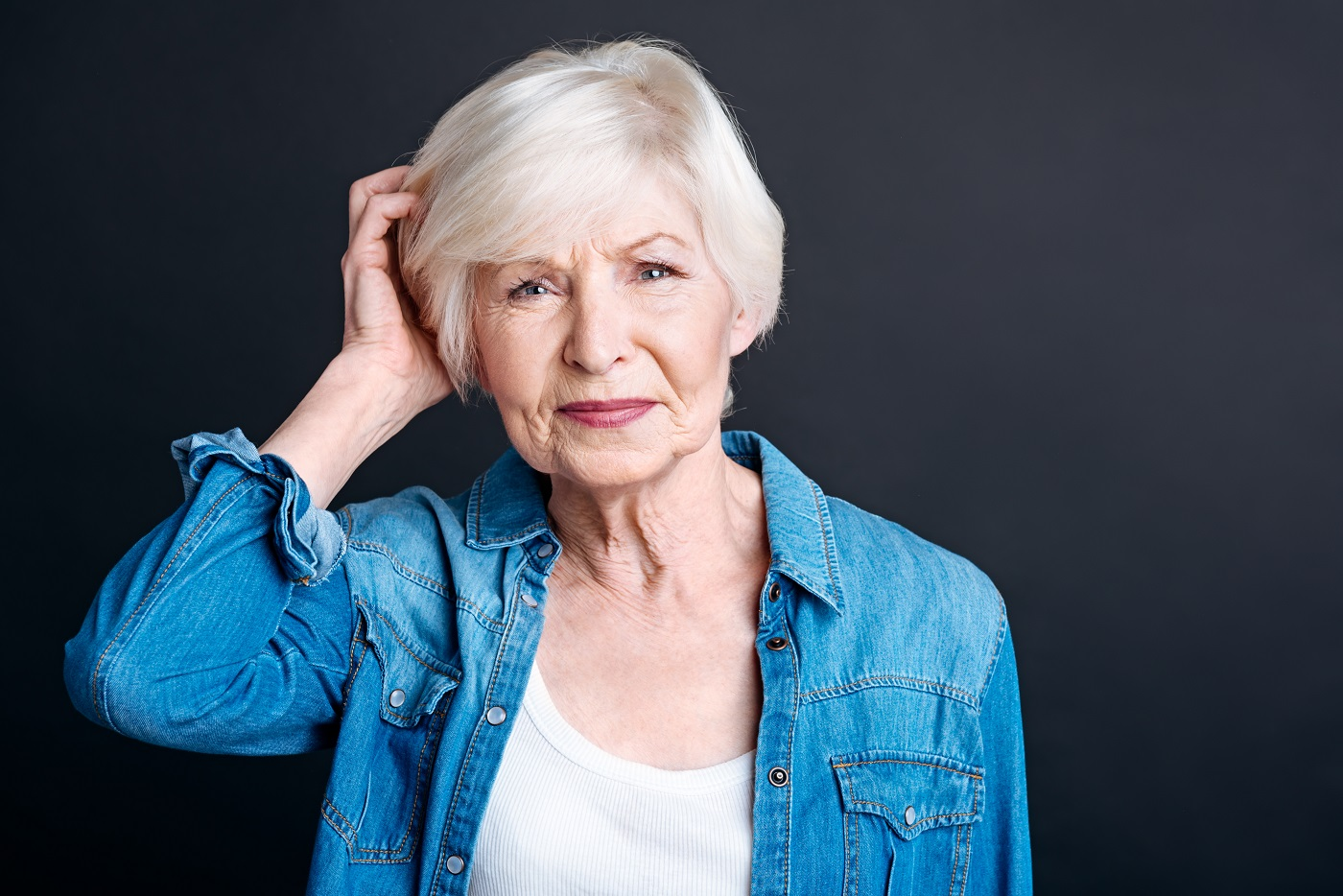 older woman scratching head
