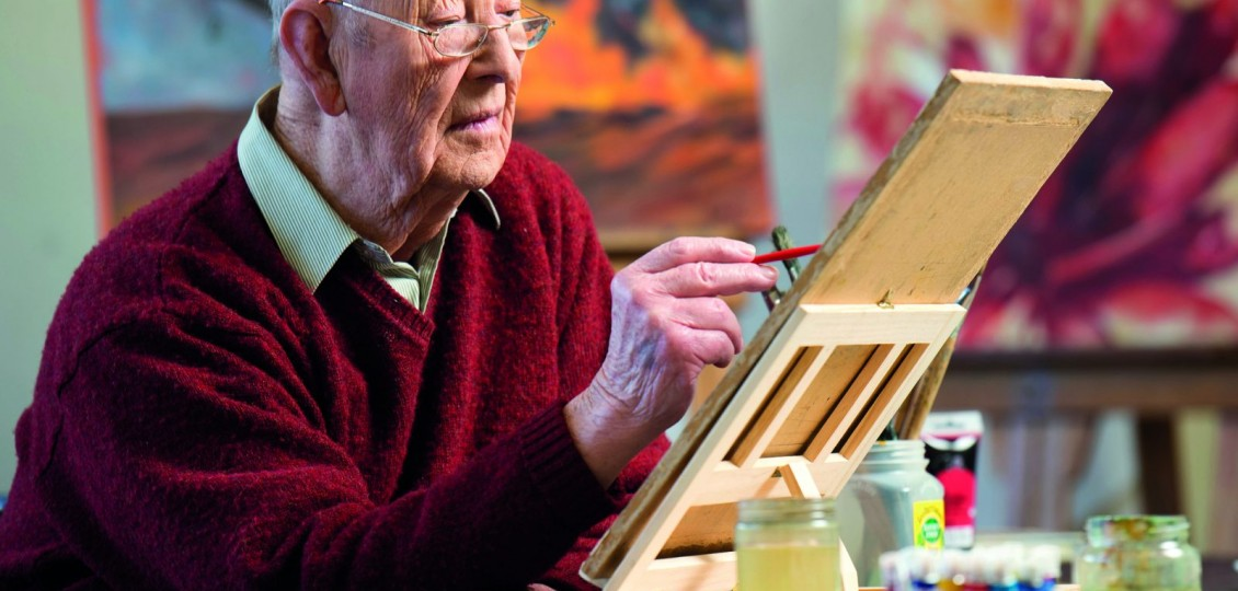 older man in aged care art class