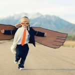 boy running with mask and fake wings
