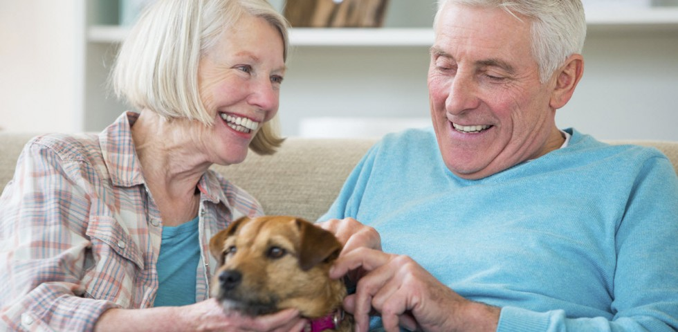 retired couple with their dog at ach group location