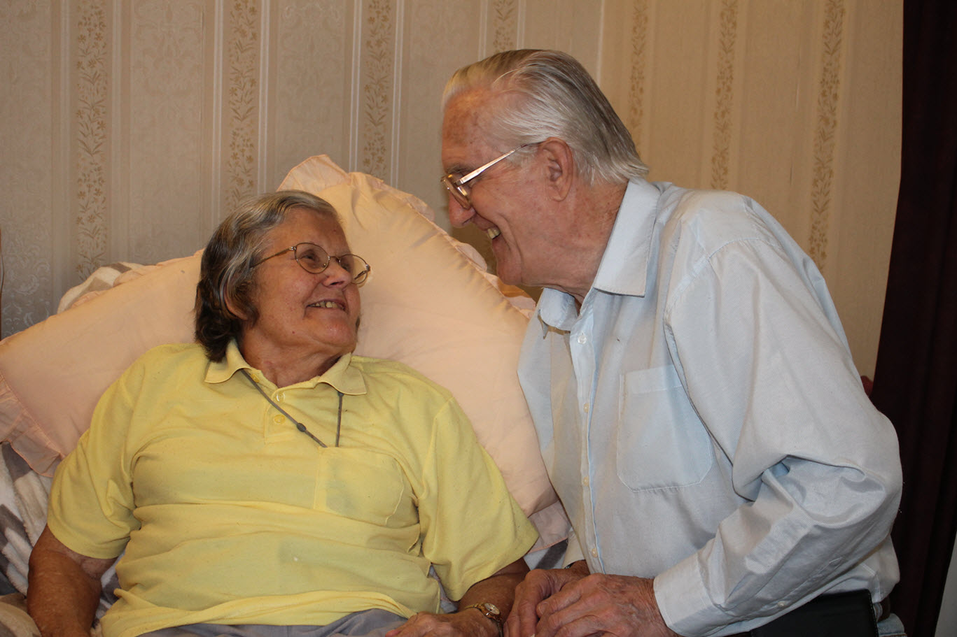 two older people smiling