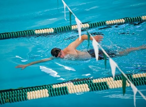older person swimming