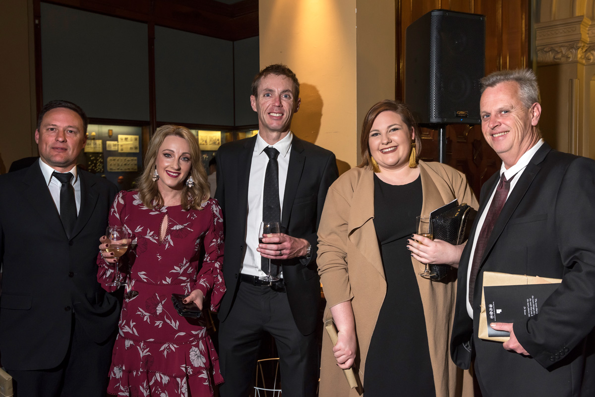 five attendees at the ACH Group awards night