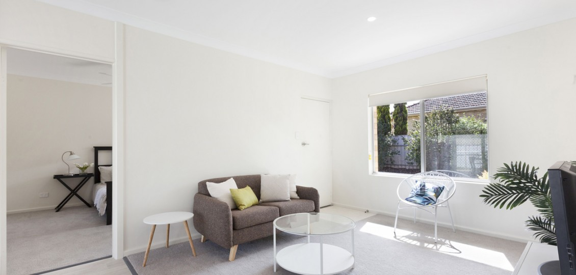 Campbelltown retirement living unit lounge room with window in background