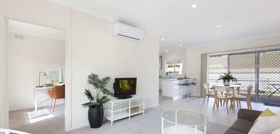 Campbelltown retirement living unit lounge room with study in background