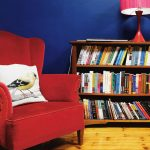bookshelf and red lounge chair