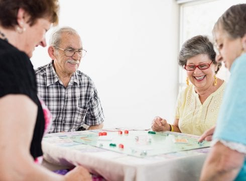 older people playing monopoly