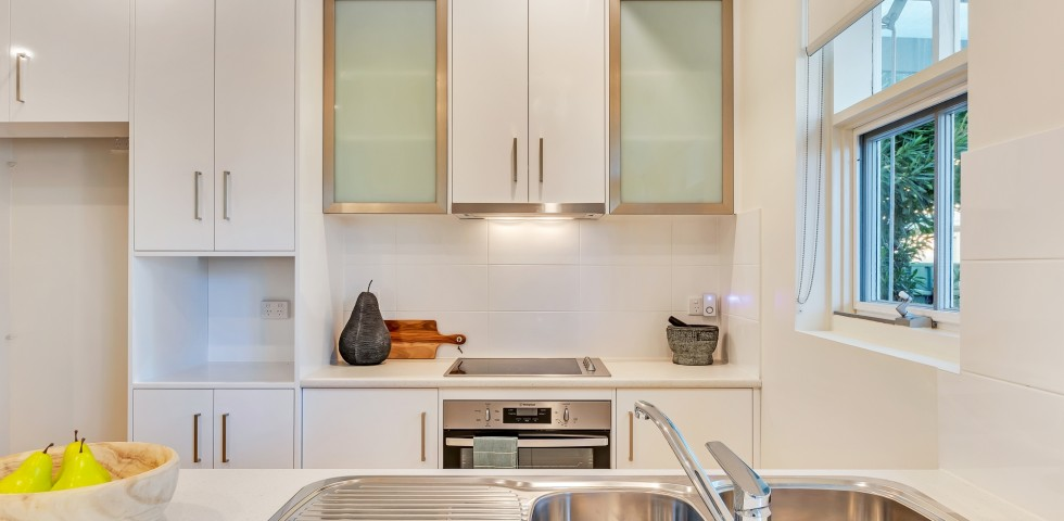 kitchen with sink in foreground at Magill retirement housing unit in adelaide
