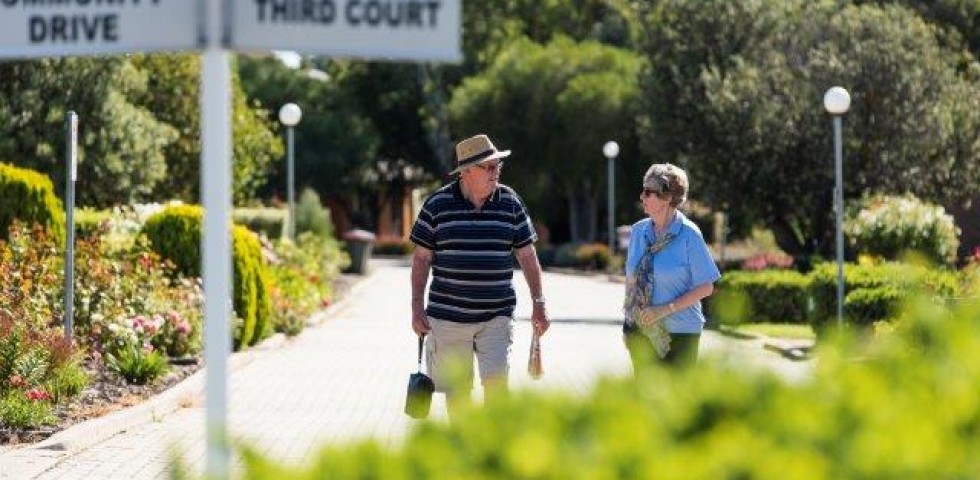 two older people walking at morphett vale retirement living unit complex
