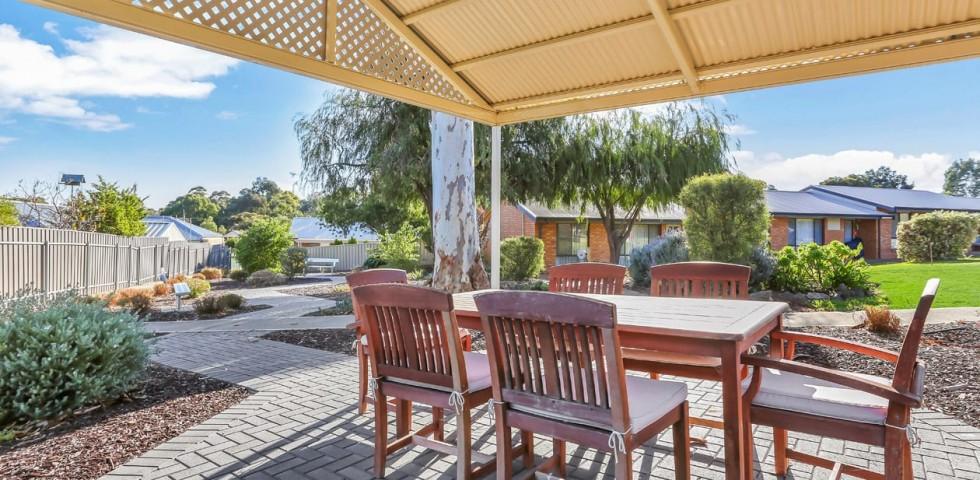 outdoor setting and pergola at morphett vale retirement living unit