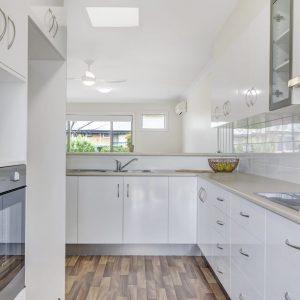 Morphett Vale retirement living unit kitchen with sink in background