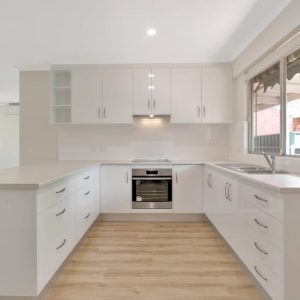 ACH Group Campbelltown retirement living unit kitchen front view