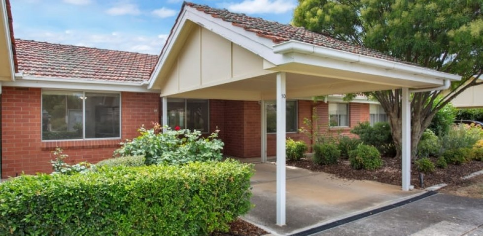 ACH Group Campbelltown retirement living unit side view with footpath