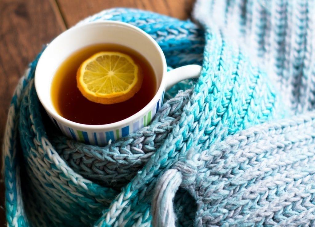 retirement living resident enjoying lemon and ginger tea in winter