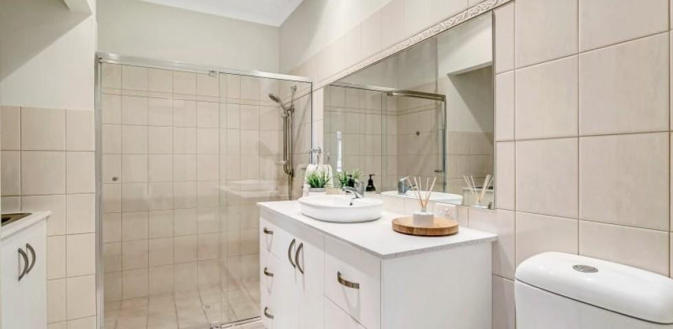 Glenelg retirement living unit bathroom with shower in background