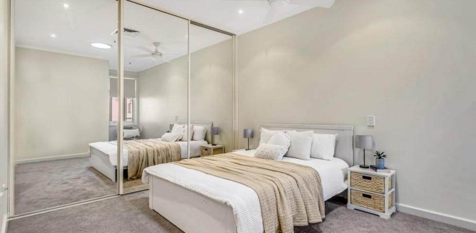 Glenelg retirement living unit bedroom with mirror