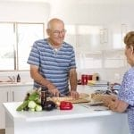 two older people cooking at morphett vale retirement living unit