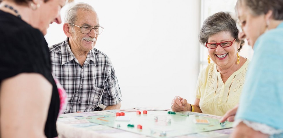 older people playing monopoly at morphett vale retirement living unit