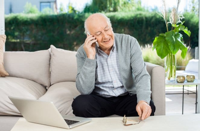 old man calling families and friends during coronavirus pandemic