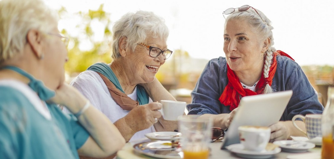 A group of older woman having coffee and enjoying their worry free retirement living lifestyle