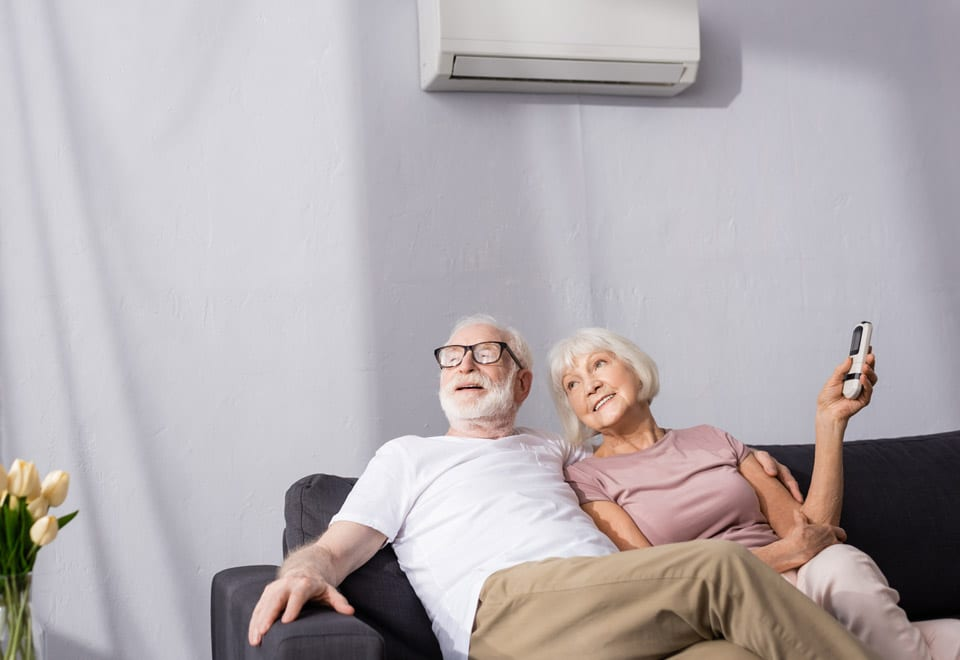 Couple enjoying air conditioning in the summer