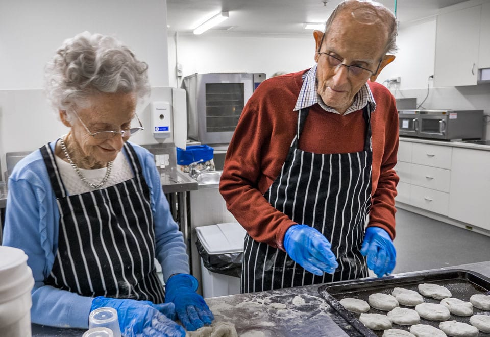 Yvonne and Fred are making scones at ACH Group Kapara nursing home